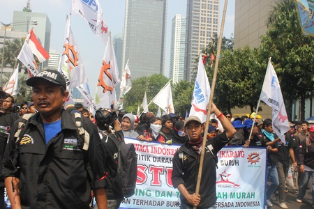 marched: Jakarta, Indonesia, July 12, 2012. Thousands of workers marched in Jakarta to protest against low wages Editorial