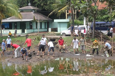 Jakarta, November 17, 2012, people work together to cleaning a lake. Editorial