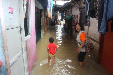 dozens: Jakarta, 17 January 2013, Flooods soak dozens of village in Jakarta.  Editorial