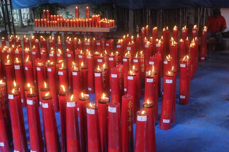 Hundreds of candles in a temple in the Lunar New Year. Editorial