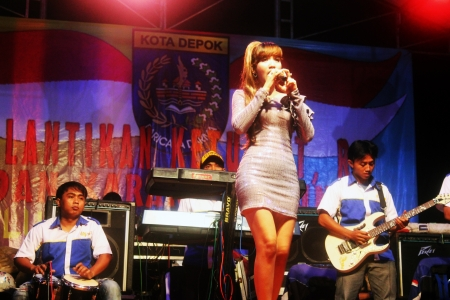 An Indonesian singer sing a dangdut song on a stage in Depok, near Jakarta, Indonesia, May 17, 2013. Editorial