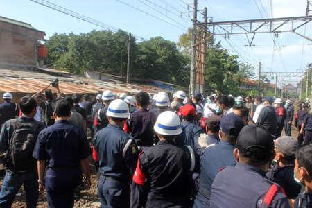 dozens: The demolition of the dozens of shops in UI Railway Station, Depok, near Jakarta, on Wednesday, 29 May 2013.
