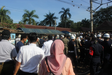 evicted: The demolition of the dozens of shops in UI Railway Station, Depok, near Jakarta, on Wednesday, 29 May 2013.
