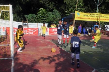 futsal: Kids playing futsal in a field in a residential complex in Depok near Jakarta, Sunday, April 9, 2013.