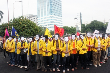 Students held rally to protest governments plan to raise the price of fuel, in front of the parliament building, Jakarta, on Monday, June 17, 2013.