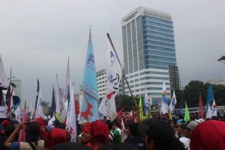marched:  Ten thousand workers marched to protest the government Editorial