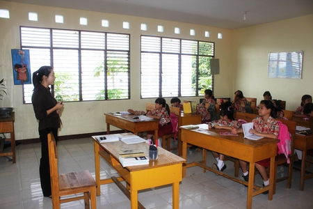 Elementary school students in Singkawang, West Kalimantan, Indonesia, are learning in the classroom  Editorial