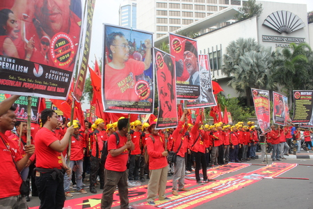 marched:  Thousands of workers marched on Labor Day in Jakarta, May 1, 2014