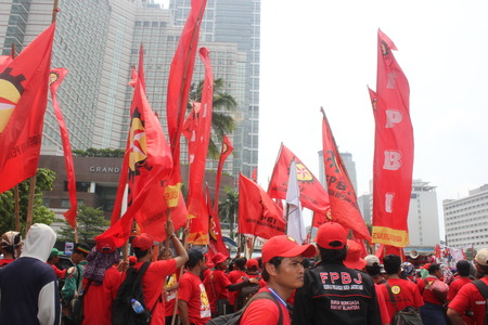 marched: Thousands of workers take to street on May Day in Jakarta, May 1, 2014