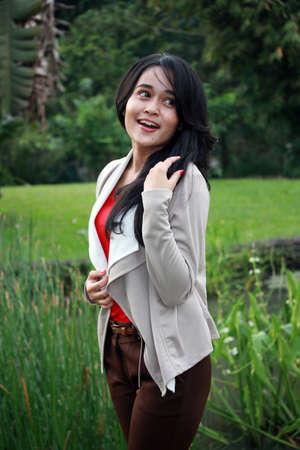 A beautiful girl smiling in a garden
