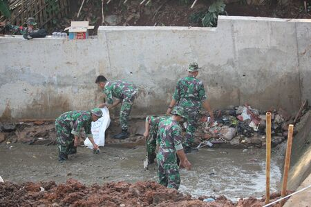 Depok, Indonesia, 13 September 2014 - Indonesian National Army to clean up the river.