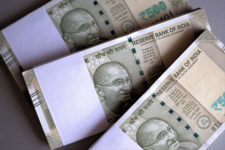Wads of Indian currency. Bundles of Indian rupees. Selective focus, Indian bank notes of five hundred rupees. Stock Photo