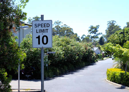 Sign post Speed Limit 10 km per hour in Australian suburb. 10 km ph speed limit street sign in Australian city.