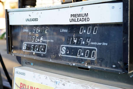 Old broken fuel vending machine. Close up of abandoned petrol diesel vending machine with prices in dollars in Australia.