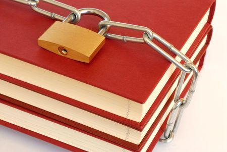 Close-up of books, chain and padlock photo