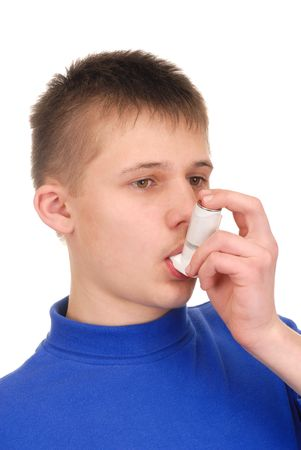 Teenager holding an inhaler isolated on white Stock Photo