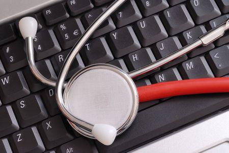 Macro of stethoscope lying on laptop keyboard Stock Photo - 3580932