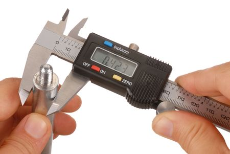 thickness: Digital caliper and hands isolated on white