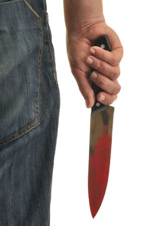 Hand holding knife with blood isolated on white