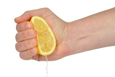 squeezed: Mano spremitura limone isolato on white
