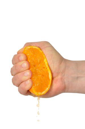 squeezed: Mano apretando naranja aislado en blanco  Foto de archivo