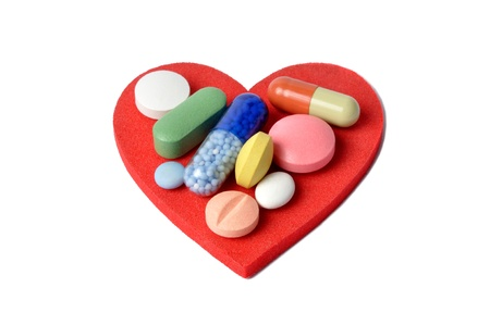 Macro of pills and capsules on red heart Stock Photo - 10286471