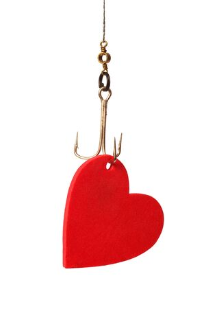 Heart hanging on a hook as a fishing bait photo