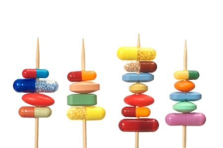 Pills on toothpicks isolated on white background Stock Photo - 13966459