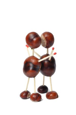 Toys made from chestnuts and matches on white background Stock Photo - 14410665