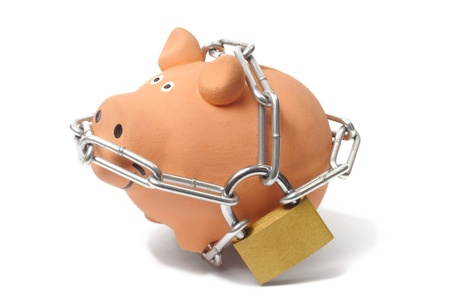 Macro of piggy bank with padlock and chains Stock Photo - 15527965