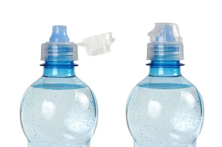 Opened and closed bottle with water on white background Stock Photo - 17191028