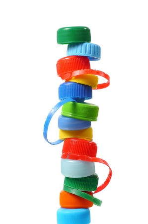 Stack made from bottle caps on white background Stock Photo - 17378445