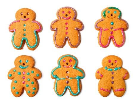 decoracion de pasteles: Gingerbread cookies aisladas sobre fondo blanco