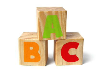 abc blocks: Three toy wooden blocks with letters ABC on them Stock Photo