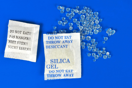 Macro of silica gel bags on blue background Stock fotó