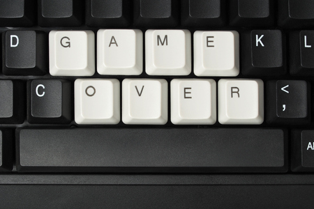 game over: Computer keyboard with keys forming words GAME OVER