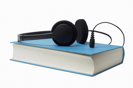 e books: Headphones and book isolated on white background