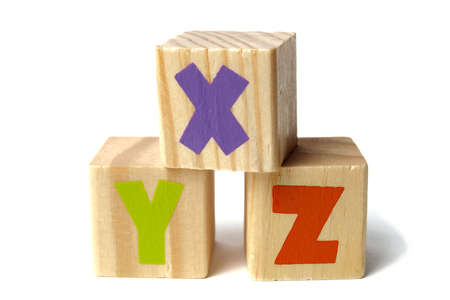 xyz: Three toy wooden blocks with letters XYZ on them