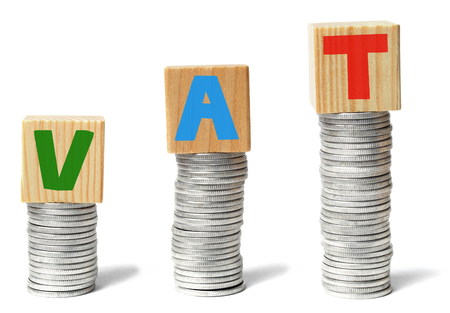 Stacks of coins and wooden blocks with letters VAT Stock fotó - 27897521