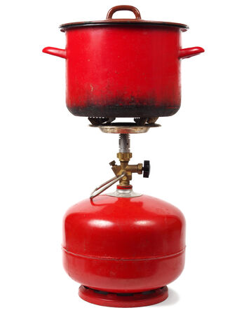 Camping gas cylinder with pot  isolated on white background photo