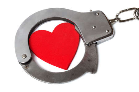 cuffed: Cuffed heart isolated on white background