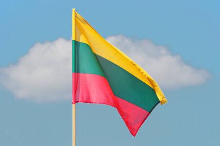lithuanian: Flag of Lithuania weaving against blue sky Stock Photo