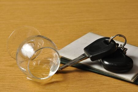 drunk driving: Glass with alcohol and car keys on a table Stock Photo