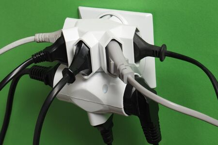 Multiple electric plugs in wall outlet Stock fotó