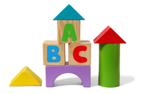 tower block: Wooden blocks with letters ABC isolated on white background