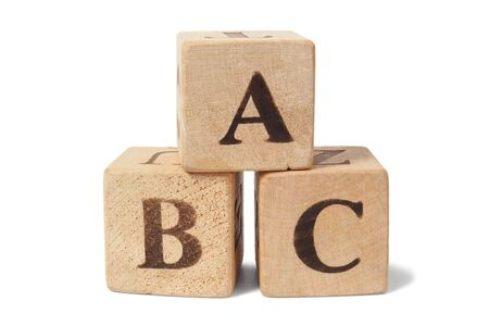 Three toy wooden blocks with letters ABC on them Stock Photo