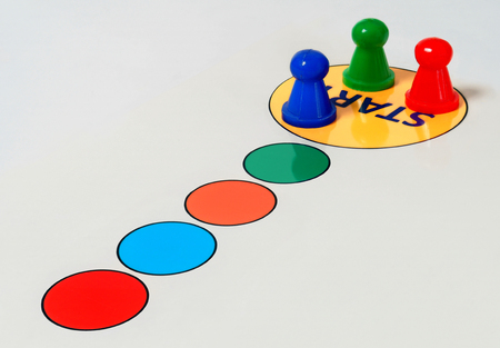 tokens: Game board and tokens at start field. Stock Photo