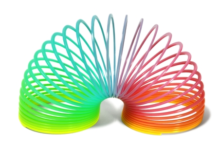 coil: Rainbow walking spring isolated on white background Stock Photo