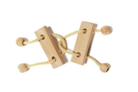 solves: Wooden puzzle on white background