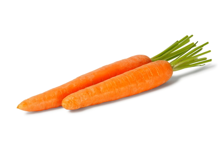 Two fresh carrots isolated on white background
